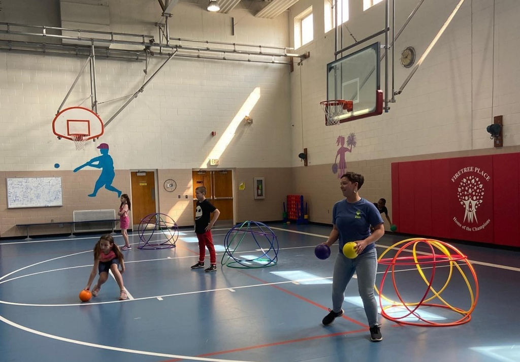firetree place kids playing ball in the gym